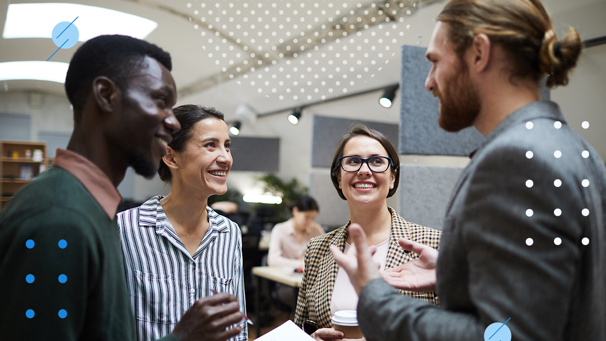 4 employees of different cultures working together at an inclusive workplace